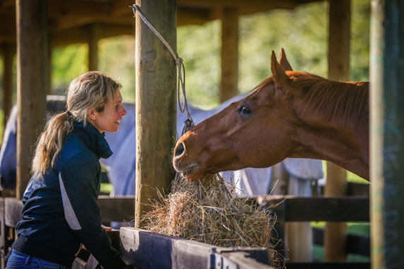 Kelley Barrington & chestnut horse - Equine Sports Medicine and Rehab Centre